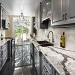 Galley Kitchen with Grey Cupboards and Granite Countertops