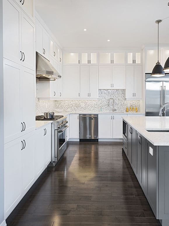 Kitchen - White Cabinets and Countertops with Dark Floors and Grey Island