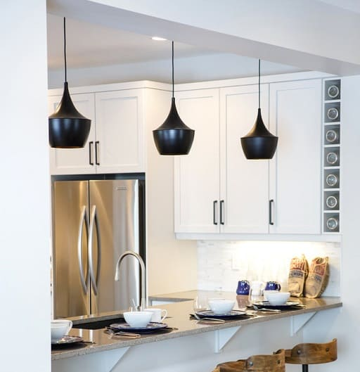 The Black Light Fixtures Make A Great Visual When Paired With White Cabinetetallic Liances Photo Credit Houzz