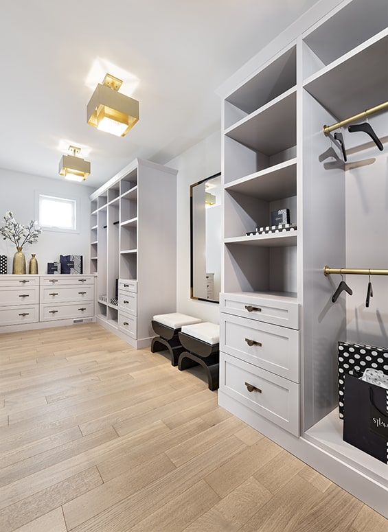 dressing room with custom grey cabinets and drawers