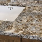 wooden vanity with granite counter - grey and brown