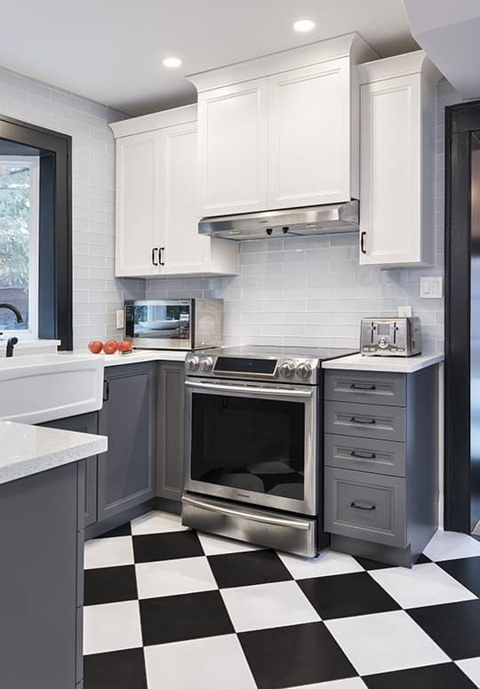 kitchen black and white tile floor grey lower cabinets white upper cabinets