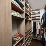 walk in closet with lots of cubbies, shoe storage, and racks
