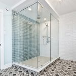 walk in shower with blue tile